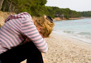 Girl Crying On Beach