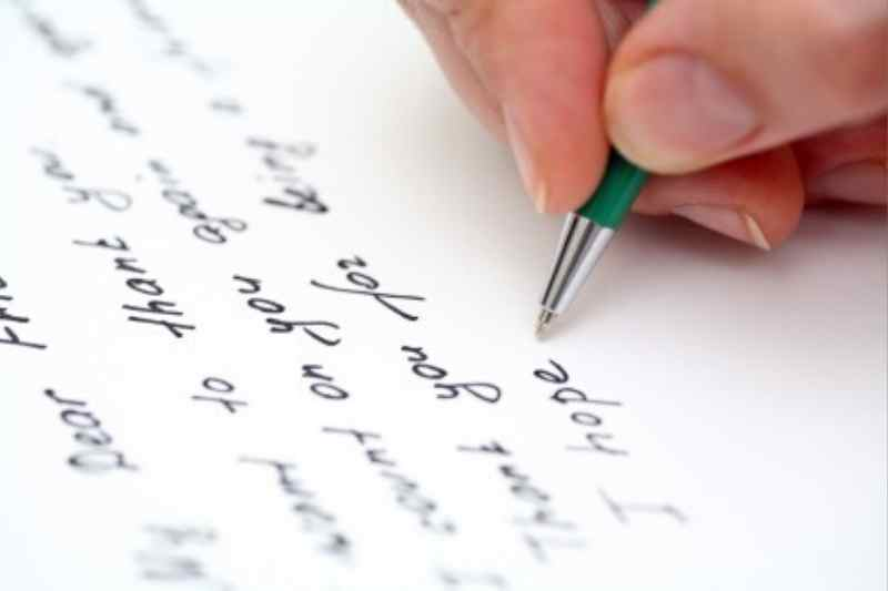 Hand writing sympathy note