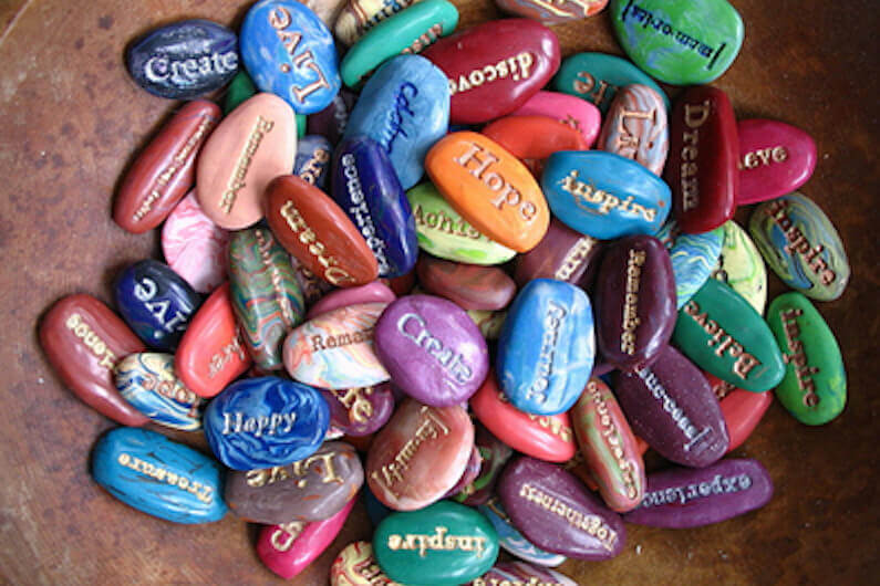 words on colored stones