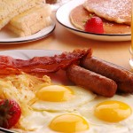 Breakfast food: eggs, bacon, sausage
