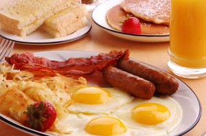 Breakfast food: eggs, bacon, sausage