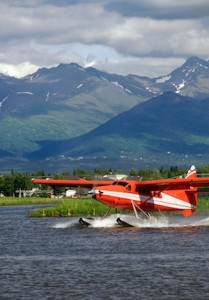 Floatplane landing on water in Alaska by Karen Gentry