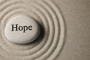 "Stone carved with ""Hope"" inside concentric circles"