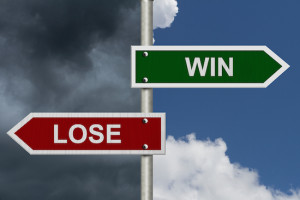Street signs showing Win and Lose