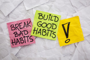 Words written on sticky notes: Build Good Habits, Break Bad Habits!