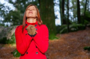 woman looking to heaven in gratitude
