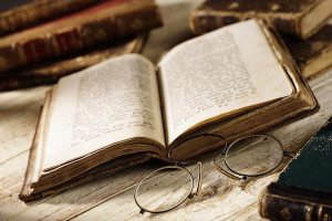 connection to antique book with old spectacles