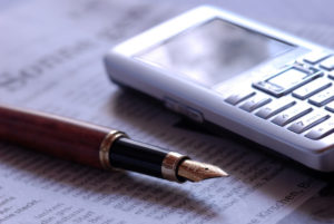Fountain pen next to cell phone - connection