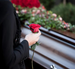 woman standing at casket