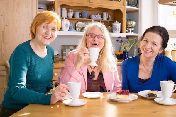 Three women friends having coffee together