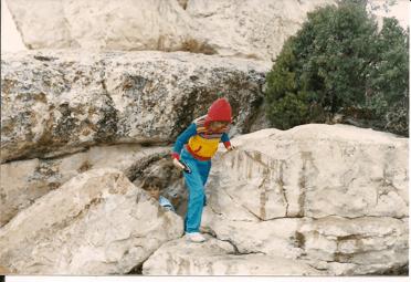 Children clamber on boulders
