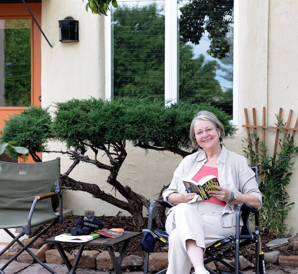 Elizabeth relaxing with a  good book at her daughter's home in Santa Fe