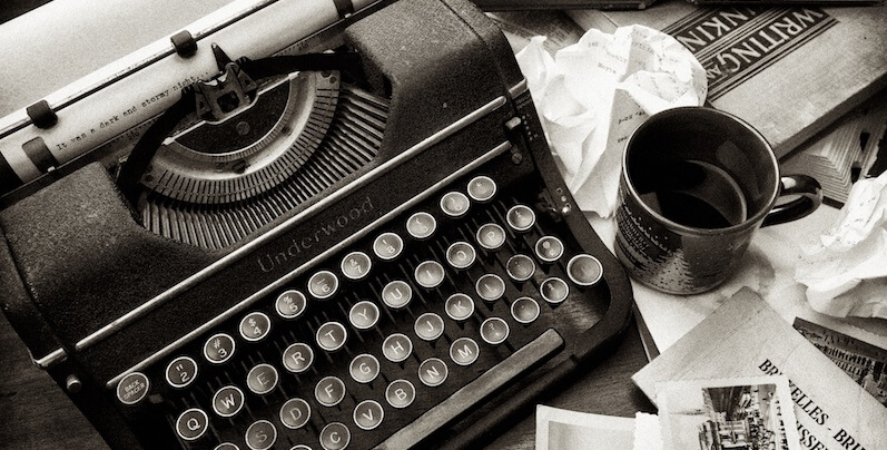 old typewriter, cup of coffee