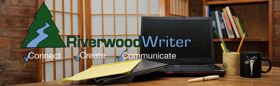 computer on desk with riverwoodwriter logo