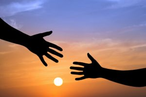 Legacy of service: Hands reaching out to help others