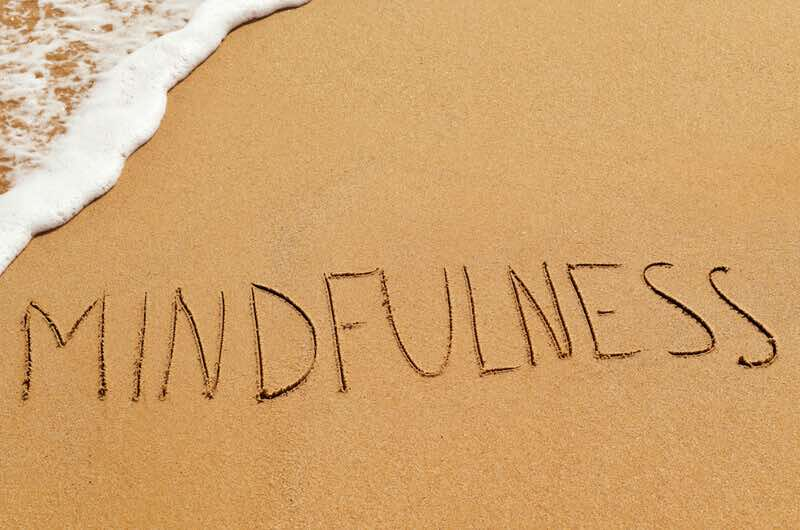 mindfulness written in the sand