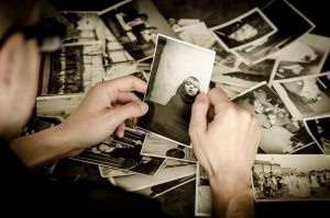 Make memories - person looking at old photographs