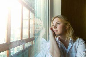 Woman contemplating God